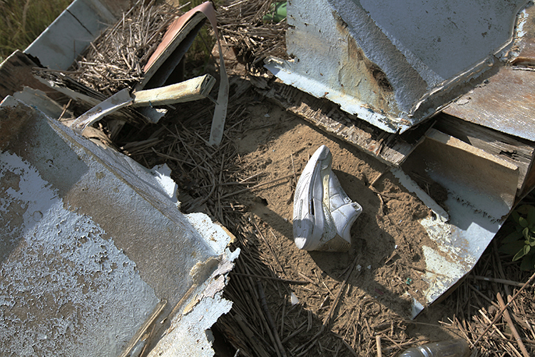 A single shoe stranded amid nautical debris.