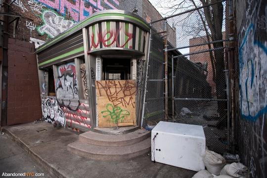 Busted windows and graffiti mar the streamline of the Kullman car
