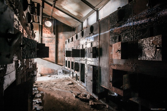 A dimly lit control room on the top floor where the coal entered the complex through a gigantic conveyor.