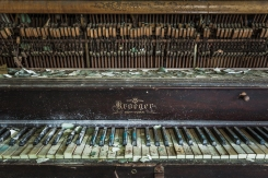 Several keys on this common room piano still functioned, though they had long gone out of tune.