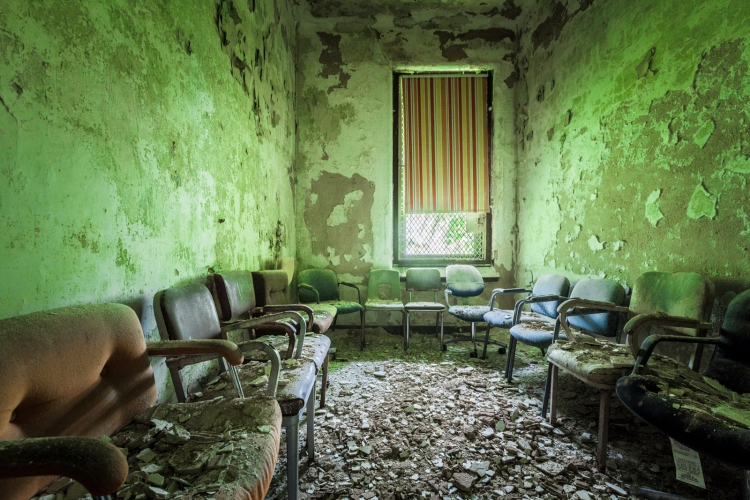 The chairs in this room were undoubtedly arranged by a previous visitor to the abandoned hospital.