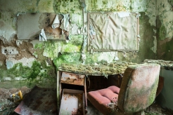 One narrow cell was far more decayed than the rest of the hospital, covered with moss and mold.