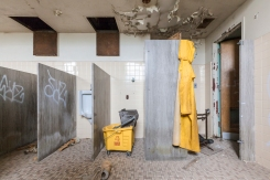 An eerie display in an administration building bathroom, which had only been abandoned in 2007.