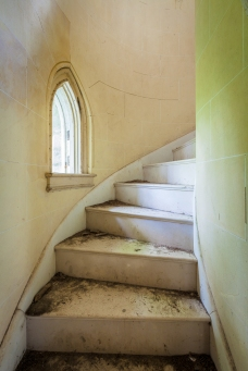 Marble spiral staircases are housed in the two towers on either side of the front entrance.