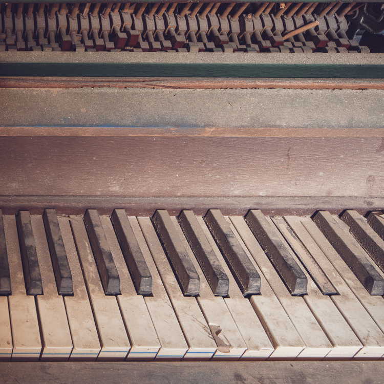 An abandoned hospital staple--the upright piano.