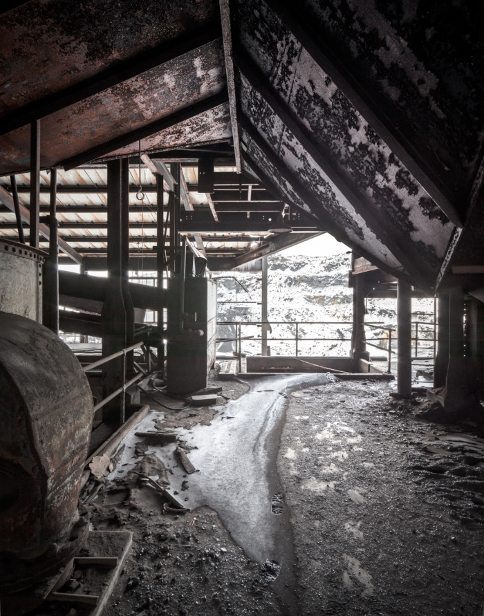 Coal dust mingles with snow drifts where the structure is open to the elements.